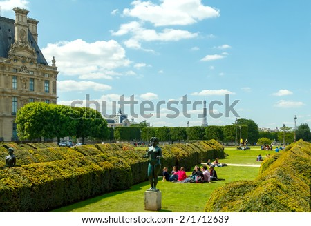 Paris, France - May 3, 2014: Tuileries Garden favorite place for walking and recreation tourists and residents. Located between the Louvre and the Place de la Concorde. - stock photo