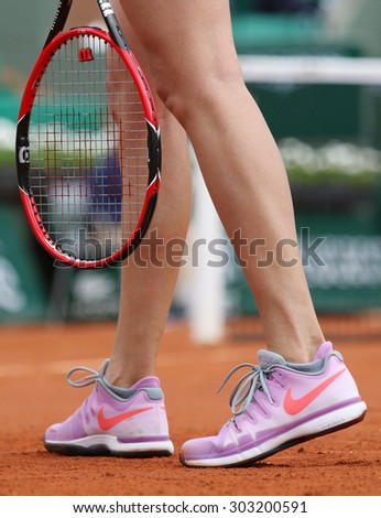 PARIS, FRANCE- MAY 28, 2015: Two times Grand Slam champion Petra kvitova wears custom Nike shoes during third round match at Roland Garros 2015 in Paris, France - stock photo