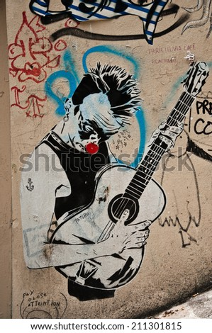 Paris - France - 27 May 2013 - urban art - musician play guitar