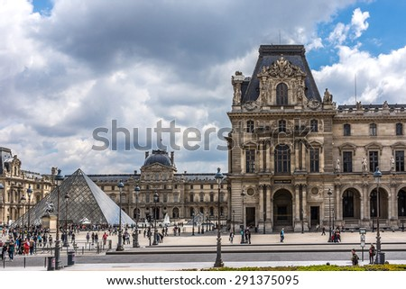 PARIS, FRANCE - MAY 15, 2014: View of Glass pyramid and illuminated buildings in the courtyard of the Louvre Museum at night. The Louvre is one of the largest and most visited museums worldwide. - stock photo