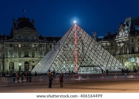 PARIS, FRANCE - MAY 15, 2014: View of Glass pyramid and illuminated buildings in the courtyard of the Louvre Museum at night. The Louvre is one of the largest and most visited museums worldwide.