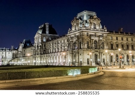 PARIS, FRANCE - MAY 15, 2014: View of illuminated buildings in the courtyard of the Louvre Museum at night. The Louvre is one of the world's largest museums. - stock photo