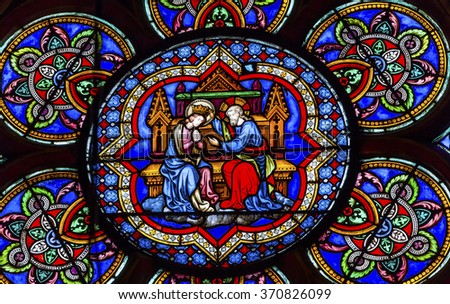 PARIS, FRANCE -  MAY 31, 2015 Virgin Mary Jesus Christ Stained Glass Notre Dame Cathedral Paris France.  Notre Dame was built between 1163 and 1250 AD.   - stock photo
