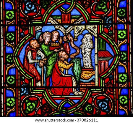 PARIS, FRANCE -  MAY 31, 2015 Worshiping Virgin Mary Jesus Christ Stained Glass Notre Dame Cathedral Paris France.  Notre Dame was built between 1163 and 1250 AD.   - stock photo