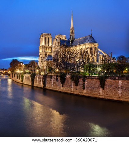 Paris, France: Notre Dame cathedral at dusk with Seine river on foreground