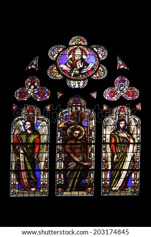 PARIS, FRANCE - NOV 11, 2012: Baptism of the Lord, stained glass from Church of St-Germain-l'Auxerrois founded in the 7th century, was rebuilt many times over several centuries.