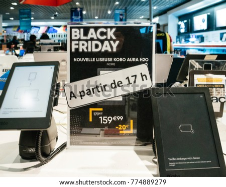 PARIS, FRANCE - NOV 23, 2017: Black Friday store shopping day in France, Paris with customers people in background buying electronics gadget in Fnac retail chain