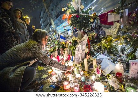 PARIS, FRANCE - Nov 29, 2015: Flowers near theater Le Bataclan in tribute to victims of the Nov. 13, 2015 terrorist attack in Paris - stock photo