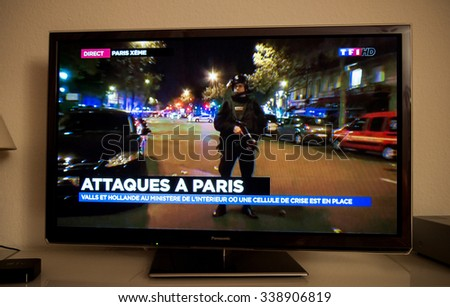 PARIS, FRANCE - NOV 13, 2015: French Television reporting live as rescuers working on the schene of the attack At least 40 people were killed across Paris, with explosions outside the national stadium - stock photo