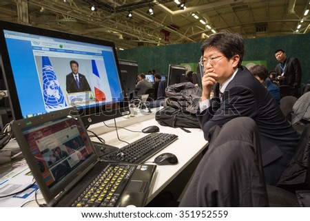 PARIS, FRANCE - Nov 30, 2015: Hard work in the press centre during the 21st session of the UN Conference on Climate Change