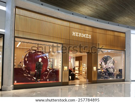 PARIS, FRANCE - NOV.12, 2014: Hermes store at the Paris Charles de Gaulle Airport. Hermes is a French company founded in 1837, specialized in high-fashion clothing and accessory manufacture and retail - stock photo