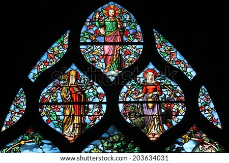 PARIS,FRANCE - NOV 11,2012:Holy bishop (Lazarus?), St. Martha, Christ, stained glass.The Church of St Severin is Catholic church in the Latin Quarter.It is one of the oldest churches on the Left Bank. - stock photo