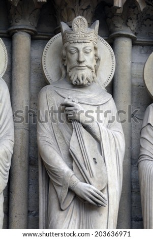 PARIS, FRANCE - NOV 05, 2012: King David, architectural detail of Notre Dame cathedral. Portal of St. Ann.
