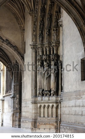 PARIS, FRANCE - NOV 11, 2012: Medieval Gothic statues, Church of St-Germain-l'Auxerrois founded in the 7th century, was rebuilt many times over several centuries.