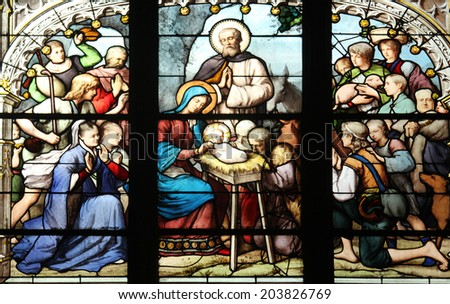 PARIS,FRANCE - NOV 11, 2012:Nativity Scene,adoration of the shepherds,stained glass.The Church of St Severin is Catholic church in the Latin Quarter. It is one of the oldest churches on the Left Bank. - stock photo
