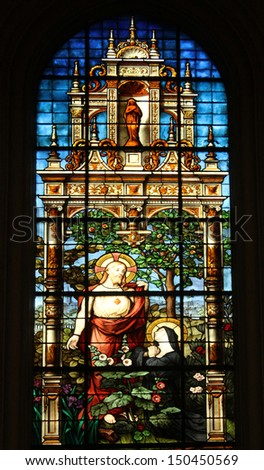 PARIS, FRANCE - NOV 07, 2012: Sacred Heart of Jesus and Marguerite Marie Alacoque, stained glass, Church of St. Gervais and St. Protais, France on Nov 07, 2012 - stock photo