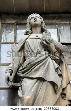 PARIS, FRANCE - NOV 09, 2012: Saint Agnes of Rome, architectural details of Eglise de la Madeleine. Church was designed in its present form as a temple to the glory of Napoleon's army.