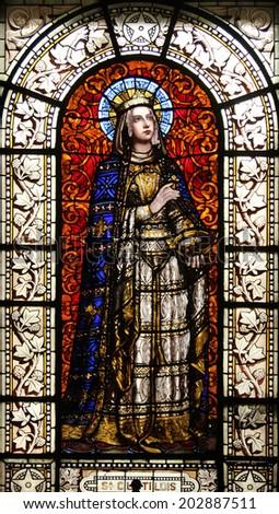 PARIS, FRANCE - NOV 10, 2012: Saint Clotilde, stained glass, Saint-Vincent-de-Paul Church (design Jean-Baptiste Lepere, was built during 1824 - 1844) dedicated to Saint Vincent de Paul - stock photo