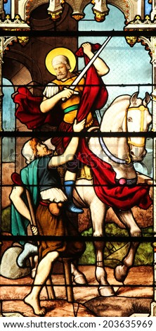 PARIS, FRANCE - NOV 11, 2012: Saint Martin, stained glass. St Severin is Catholic church in the Latin Quarter. It is one of the oldest churches on the Left Bank. - stock photo