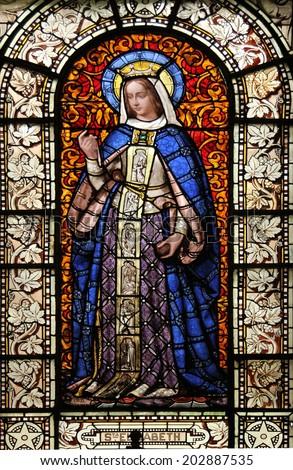 PARIS, FRANCE - NOV 10, 2012: St. Elizabeth, stained glass, Saint-Vincent-de-Paul Church (design Jean-Baptiste Lepere, was built during 1824 - 1844) dedicated to Saint Vincent de Paul.   - stock photo