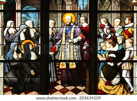 PARIS, FRANCE - NOV 11, 2012: St. Francis de Sales handing St Jeanne de Chantal in the constitutions of the Order of the Visitation. The Church of St Severin is Catholic church in the Latin Quarter.  - stock photo