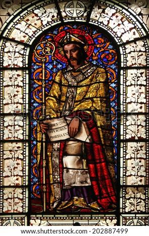 PARIS, FRANCE - NOV 10, 2012: St. Martin, stained glass, Saint-Vincent-de-Paul Church (design Jean-Baptiste Lepere, was built during 1824 - 1844) dedicated to Saint Vincent de Paul - stock photo