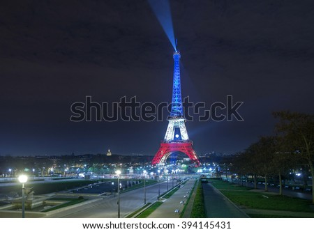 PARIS. FRANCE. NOV 24, 2015: The Eiffel tower illuminated up with the colors Of the French national flag to honor the victims terrorist attacks in Paris. November 24, 2015. Paris. - stock photo