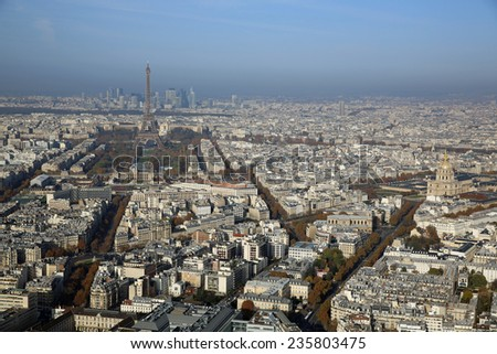 PARIS, FRANCE - NOVEMBER 23, 2014:Aerial View from the Top of Maine-Montparnasse Tower to Eiffel Tower and La Defense  - stock photo