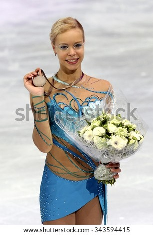 PARIS, FRANCE - NOVEMBER 16, 2013: Anna POGORILAYA of Russia poses during the victory ceremony at Trophee Bompard ISU Grand Prix at Palais Omnisports de Bercy. - stock photo