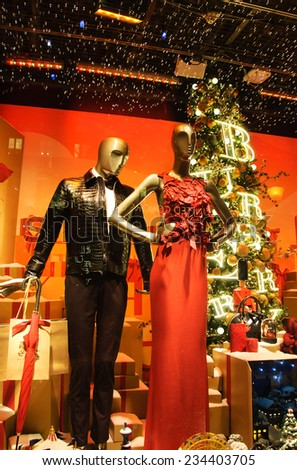 PARIS, FRANCE - NOVEMBER 22, 2014: Colorful Christmas decoration by Burberry in the windows of Printemps department store attracts Parisian children and tourists. - stock photo