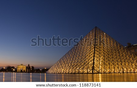 PARIS,FRANCE - NOVEMBER 06: Entrance to Louvre Museum and Arc de Triomphe du Carrousel on November 06, 2012 in Paris. The crystal pyramid was completed in 1989, it has become a landmark of of Paris.