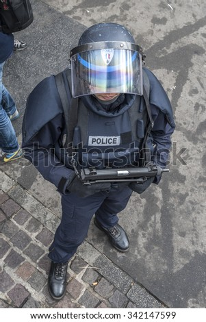 PARIS, FRANCE - NOVEMBER 18, 2015 : French policeman on duty after the terrorist attacks in Paris on 13 November 2015. - stock photo