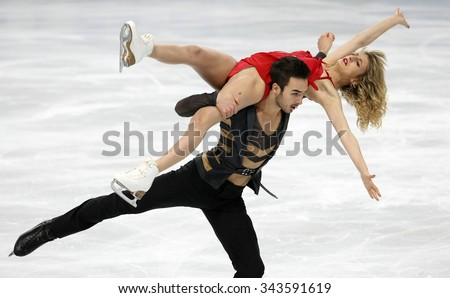 PARIS, FRANCE - NOVEMBER 16, 2013: Gabriella PAPADAKIS / Guillaume CIZERON of France perform free dance at Trophee Bompard ISU Grand Prix at Palais Omnisports de Bercy. - stock photo
