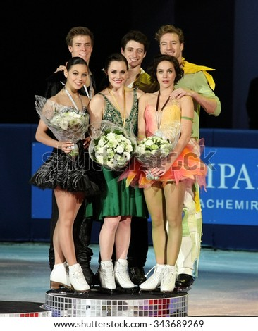 PARIS, FRANCE - NOVEMBER 16, 2013: ILINYKH/KATSALAPOV (L); VIRTUE/MOIR; PECHALAT/BOURZAT pose during the victory ceremony in ice dance at Trophee Bompard ISU Grand Prix at Palais Omnisports de Bercy. - stock photo