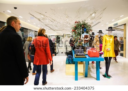 PARIS, FRANCE - NOVEMBER 22, 2014: Interior of  Printemps department store decorated for the Christmas season. Printemps is one of well-known Parisian department store located on Boulevard Haussmann. - stock photo