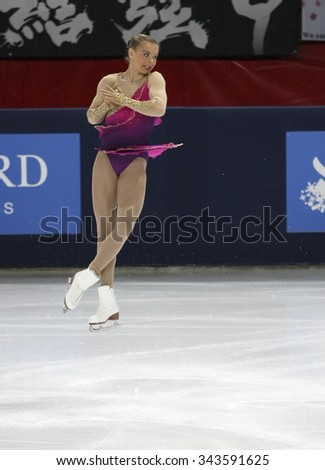 PARIS, FRANCE - NOVEMBER 16, 2013: Natalia POPOVA of Ukraine performs free program at Trophee Bompard ISU Grand Prix at Palais Omnisports de Bercy. - stock photo