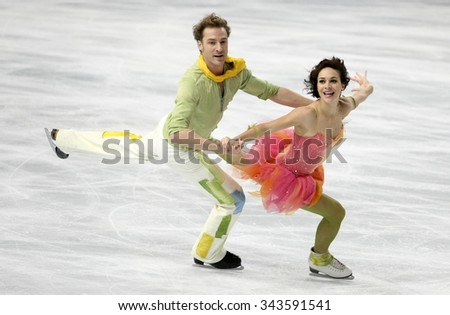 PARIS, FRANCE - NOVEMBER 16, 2013: Nathalie PECHALAT / Fabian BOURZAT of France perform free dance at Trophee Bompard ISU Grand Prix at Palais Omnisports de Bercy. - stock photo