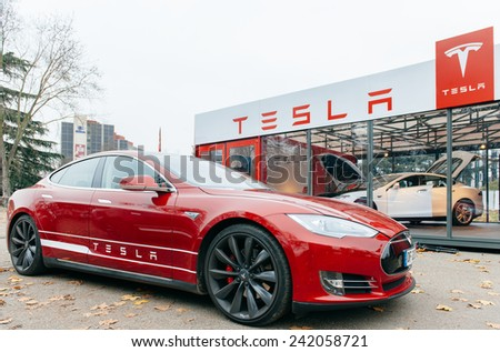 PARIS, FRANCE - NOVEMBER 29, 2014: New Tesla Model S showroom has arrived in Paris, France. Tesla is an American company that designs, manufactures, and sells electric cars - stock photo