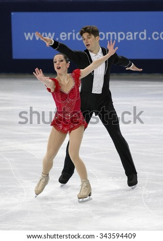 PARIS, FRANCE - NOVEMBER 16, 2013: Nicole DELLA MONICA / Matteo GUARISE of Italy perform free program at Trophee Bompard ISU Grand Prix at Palais Omnisports de Bercy. - stock photo