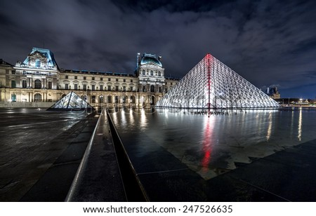 Paris, France - November 16, 2014: Night view of The Louvre museum with crystal pyramid. One of the most visited museum in the world. - stock photo