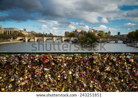 PARIS, FRANCE -  NOVEMBER 9, 2014 Panoramic view on Paris Ponte des Arts over river Seine. Famous from love lock left by lovers from all around the world - stock photo