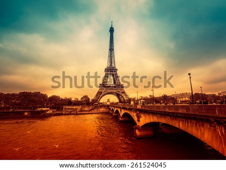 Paris, France - november 18, 2014: Paris cityscape, intense and dramatic colors with Eiffel Tower in background. Vintage effects - stock photo