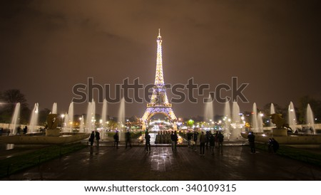 Paris, France - November 26, 2014: Paris cityscape with Eiffel tower in Paris, France. It's an iron lattice tower located on the Champ de Mars and named after the engineer Gustave Eiffel. - stock photo