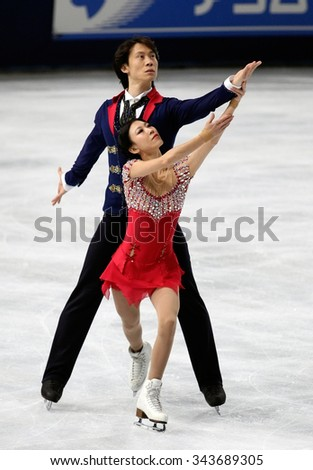 PARIS, FRANCE - NOVEMBER 16, 2013: Qing PANG / Jian TONG of China perform free program at Trophee Bompard ISU Grand Prix at Palais Omnisports de Bercy. - stock photo