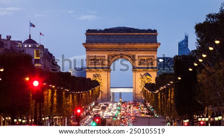 PARIS, FRANCE - NOVEMBER 1: The Arc de Triomphe (Arch of Triumph of the Star) at sunset photographed along the boulevard Champs-Elysees on November 1, 2012. One of the most famous monuments in Paris.