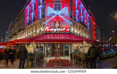 Paris, France-November 26, 2016 : The Christmas decoration on Fouquet's restaurant located at Champs Elysees avenue in Paris.Fouquet's is a historic restaurant was founded in 1889.