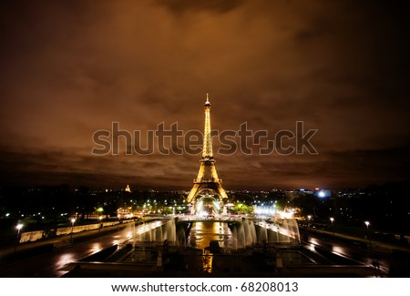 PARIS, FRANCE - NOVEMBER 12: The Eiffel tower lit at Night on November 12, 2010 in Paris, France. The most visited monument of France. - stock photo