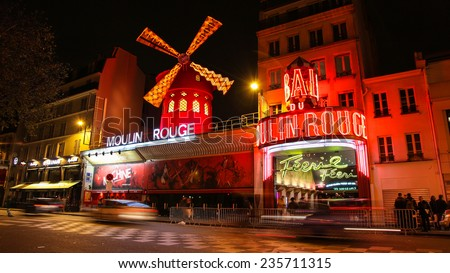 Paris, France - November 24, 2014: The Moulin Rouge cabaret in Paris, France. Moulin Rouge is best known as the spiritual birthplace of the modern form of the can-can dance. - stock photo