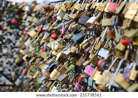 PARIS, FRANCE - NOVEMBER 23, 2014: The Pont des Arts in the Center of Paris. It is now full of Love Lockers - stock photo