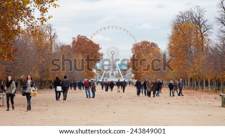 Paris, France - November 24, 2014: The Tuileries Garden is a public garden located between the Louvre and Place de la Concorde. Created by Catherine de 'Medici in 1564. - stock photo
